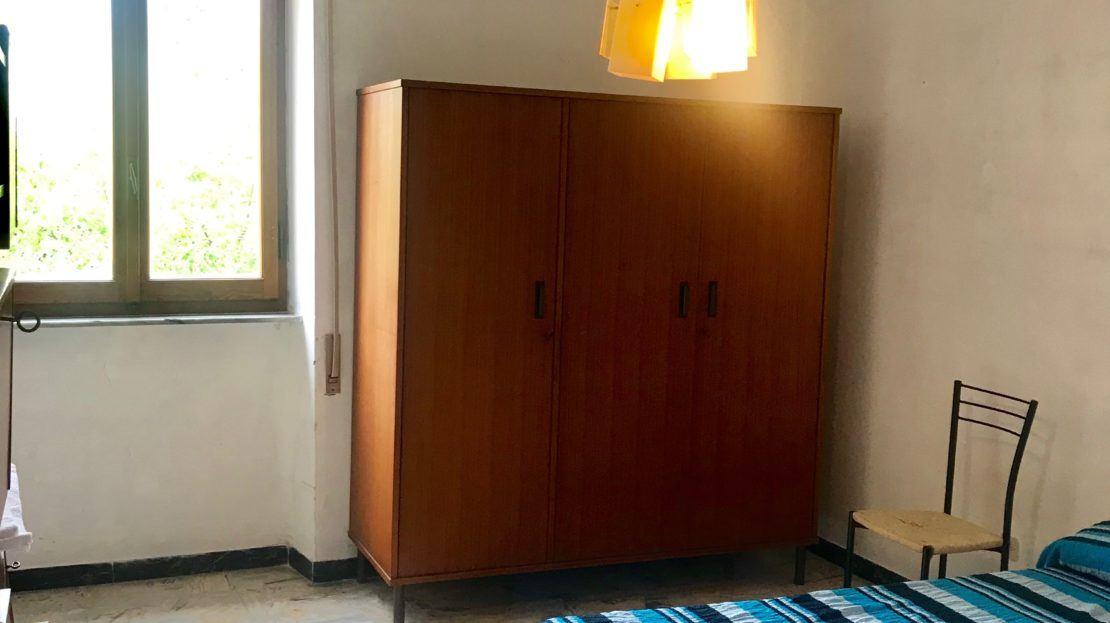 Sezione della camera da letto all'interno del trilocale Gelsomina in affitto a Giglio Porto